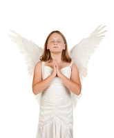 young angel girl praying on white