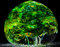 Green blown glass ball like forest leaves