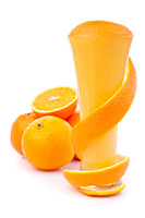 Orange peel wrapping a glass against white background