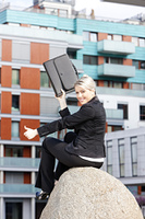 sitting young businesswoman with a briefcase