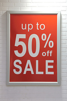 Sale sign on wall