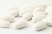 white medical tablets over white