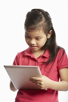 Studio Shot Of Chinese Girl With Digital Tablet