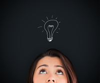 Woman looking up on the picture of bulb