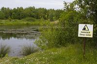 danger sign near a lake