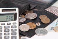 Polish money - zloty, banknotes, coins, calculator and wallet
