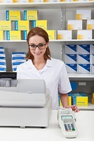 Female Pharmacist In Pharmacy