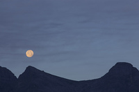 Full Moon above Mountain Ridge in the Canadian Rockies