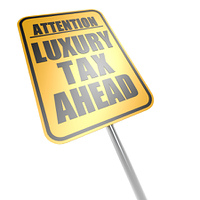 Luxury tax ahead road sign