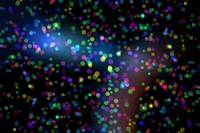 Colourful glowing dots on black