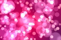 Light glowing dots on pink