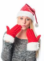 Weihnachtsfrau gibt Handkuss